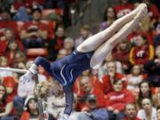 Brigham Young's KayCee Gassaway performs on the bars during a meet Jan.