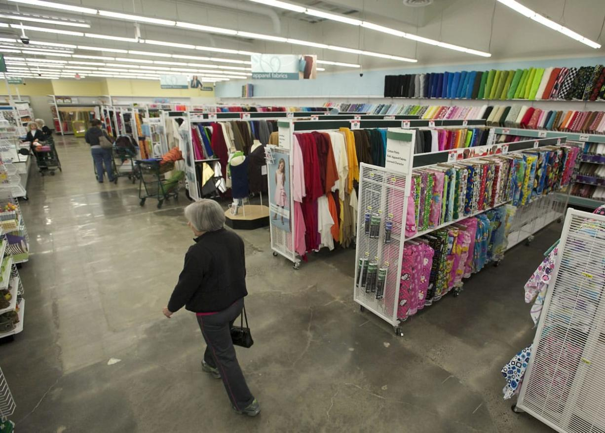 Rows of bright bolts of fabric greet shoppers in the new Jo-Ann Fabric and Craft Stores location in Hazel Dell.