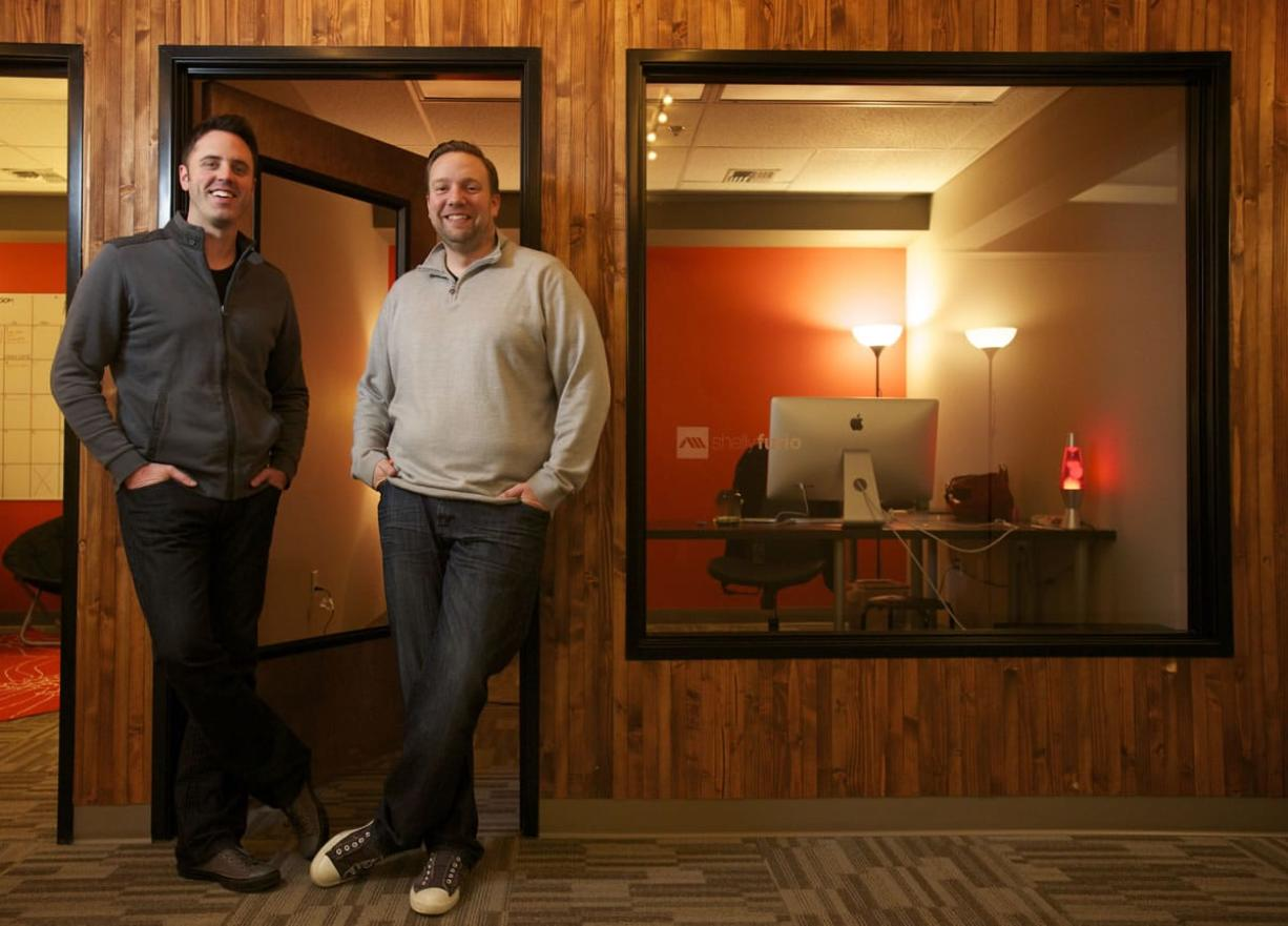 Ambient Media founders Steve Cross, left, and Matt Cole stand in their downtown Vancouver office Jan. 22.