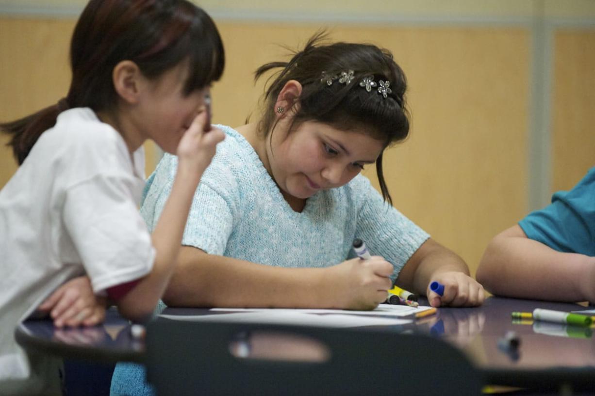 Onika Estrada, 10, left, draws  with friends at the Boys and Girls Club at Washington Elementary School on Jan. 14.