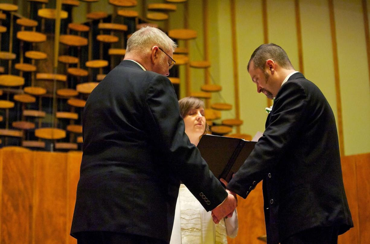 Portlanders and committed United Church of Christ members Jim McPartland, left, and Grant Edwards were wed on Nov. 9 at the First Congregational United Church of Christ in Hazel Dell. The Rev.