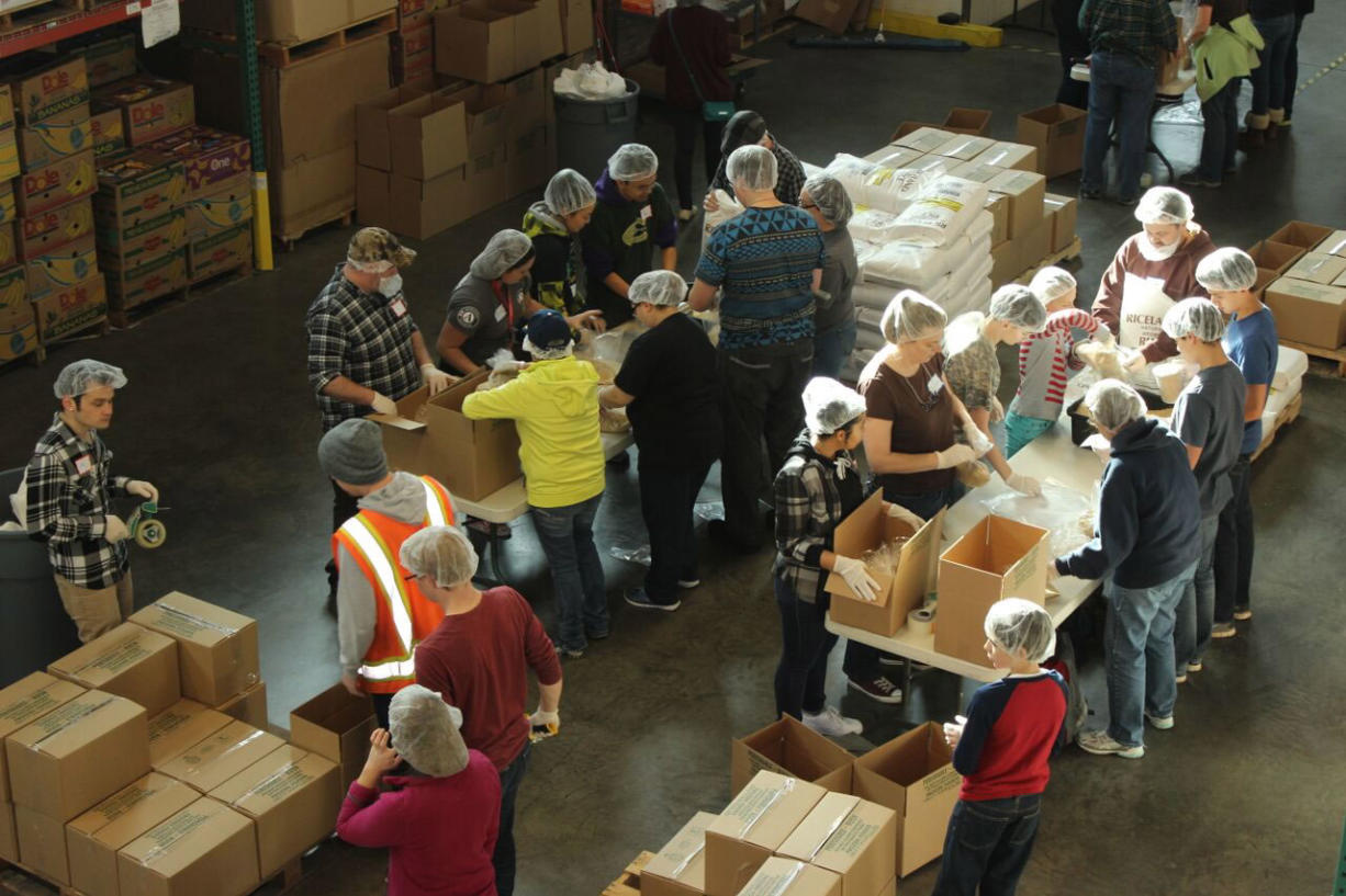 Minnehaha: More than 300 veterans and students spent Veterans Day at Clark County Food Bank packing more than 25,000 pounds of food, which will go to families in need.