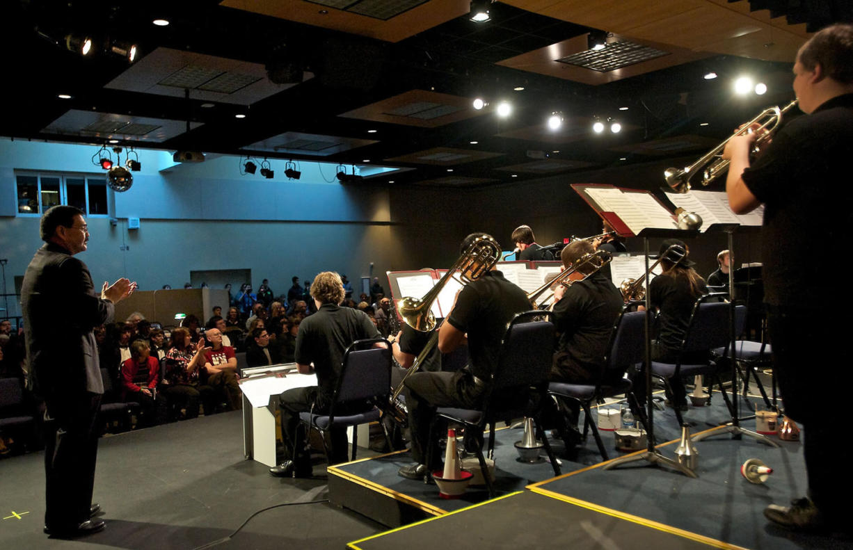 Rich Inouye, left, director of bands, applauds the Clark College Jazz Ensemble during its performance at the 52nd Annual Clark College Jazz Festival.
