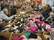 Customers sift through socks of all colors and styles at the Fred Meyer Fishers Landing store early on Black Friday. The traditional half-price sale on socks from 5 a.m. to 1 p.m. is a tradition for may local shoppers.