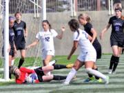 Carroll College goalkeeper Jamie Carter makes another stop.