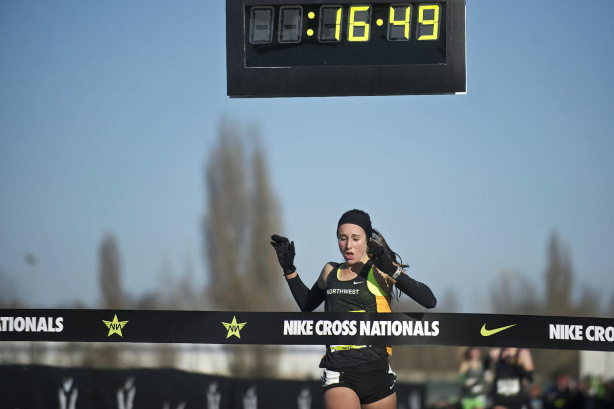 Camas' Alexa Efraimson crosses the finish line first at the Nike Cross National cross country meet and wins the national high school title at Portland Meadows on Saturday.