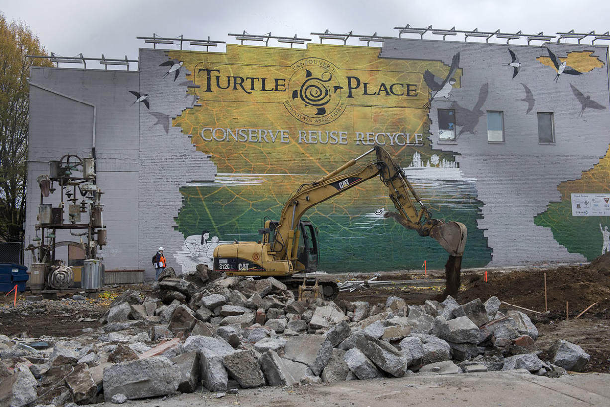 Construction crews from Tapani Underground work at downtown Vancouver's Turtle Place on the future bus terminus for The Vine, a bus rapid transit service that will run to Westfield Vancouver mall.