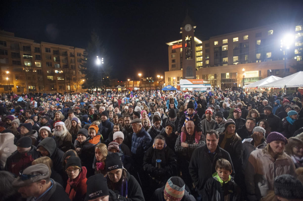 Thousands turn out to attend the annual Christmas tree lighting event at Esther Short Park on Friday night. The event kicks off the Vancouver Rotary Foundation's Festival of Trees, the group's primary fundraising event for its scholarship programs.