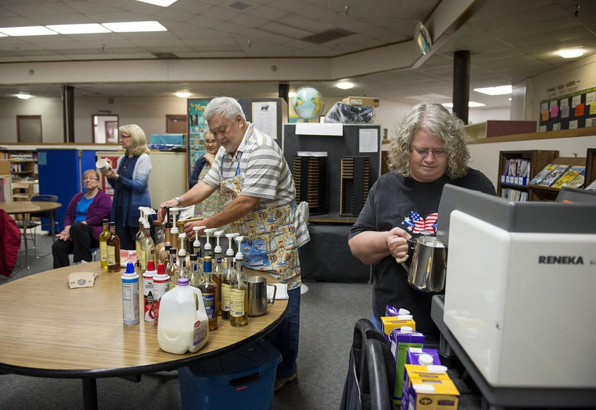 Northside Baptist Church members John Martin, center, and Cathy White, right, prepare coffee drinks for teachers and staff during a coffee cart event Nov. 10 at Gaiser Middle School. Volunteers from the church visit Gaiser and four elementary schools each month to treat teachers.