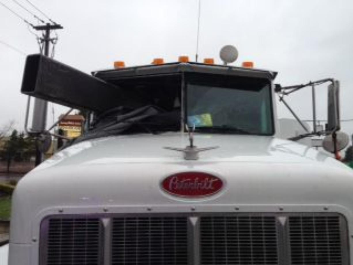 A steel beam went through the windshield of a tractor-trailer Wednesday in Tualatin, Ore. The driver, Jack Phillips of Vancouver, ducked and escaped injury.