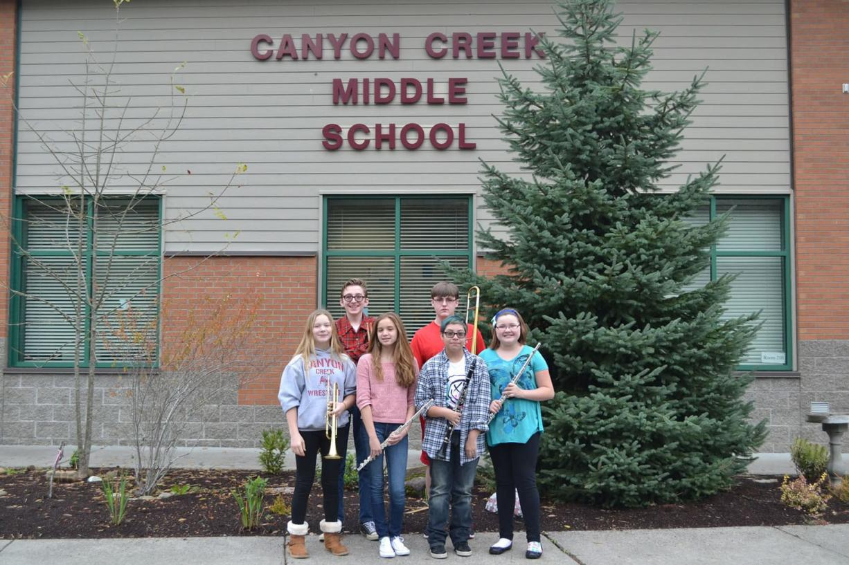 Washougal: Canyon Creek musicians Maddie Wakefield, front from left, Maliyah Veale, Jennie Mariscal, and Kelly Langston; back from left, William Weihl and Kyle Hendrickson were named to the North County Middle School Honor Band.