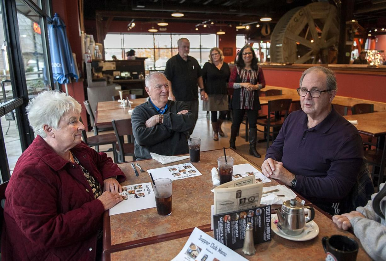 Mary Senescu, left, has a meal out with her husband, Larry, and new friends Gerry and Moira Quilling at the Mill Creek Pub. Gerry remains a great talker except when he has to fish for words; Larry is almost completely nonverbal but keeps flashing that wise smile. Behind the diners are Mill Creek Pub owner Russell Brent, Julie Williams of Home Instead Senior Care and Shanti Potts, a volunteer with the Elder Justice Center.