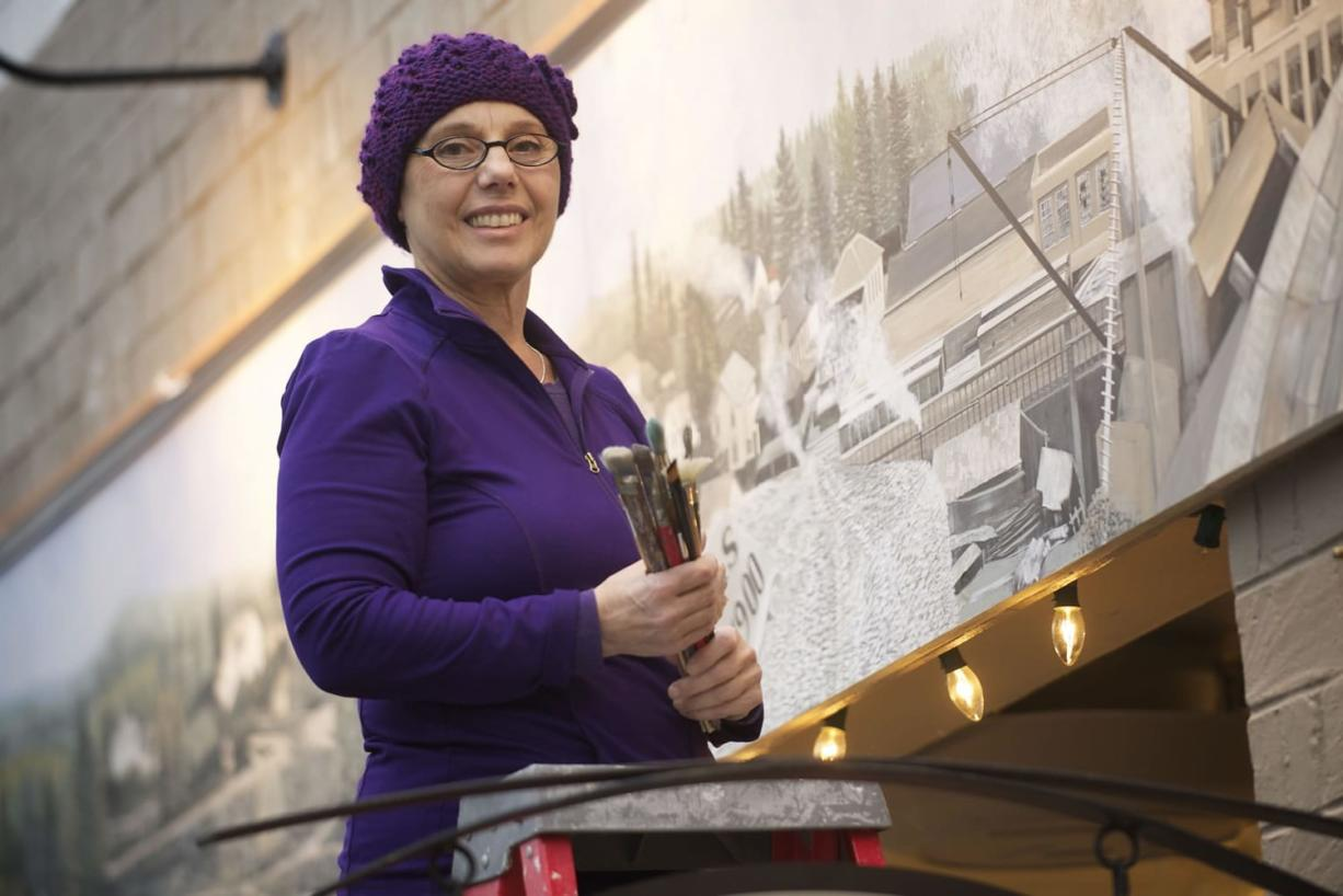 Camas artist Maria Grazia Repetto and her recently finished mural above the Camas Art Gallery.