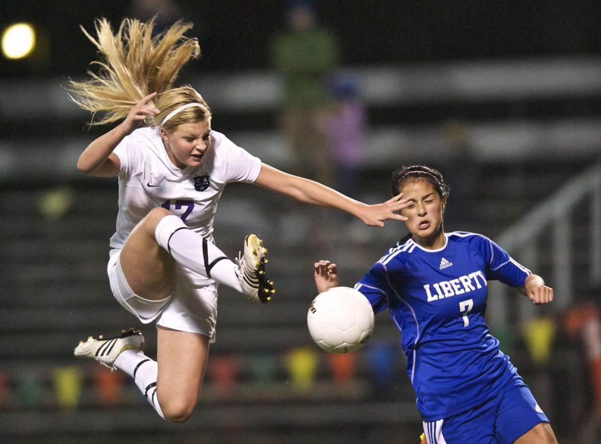 Columbia River's Madison Reynolds puts a shot on goal late in the second half against Liberty in a first-round state playoff game at Kiggins Bowl.