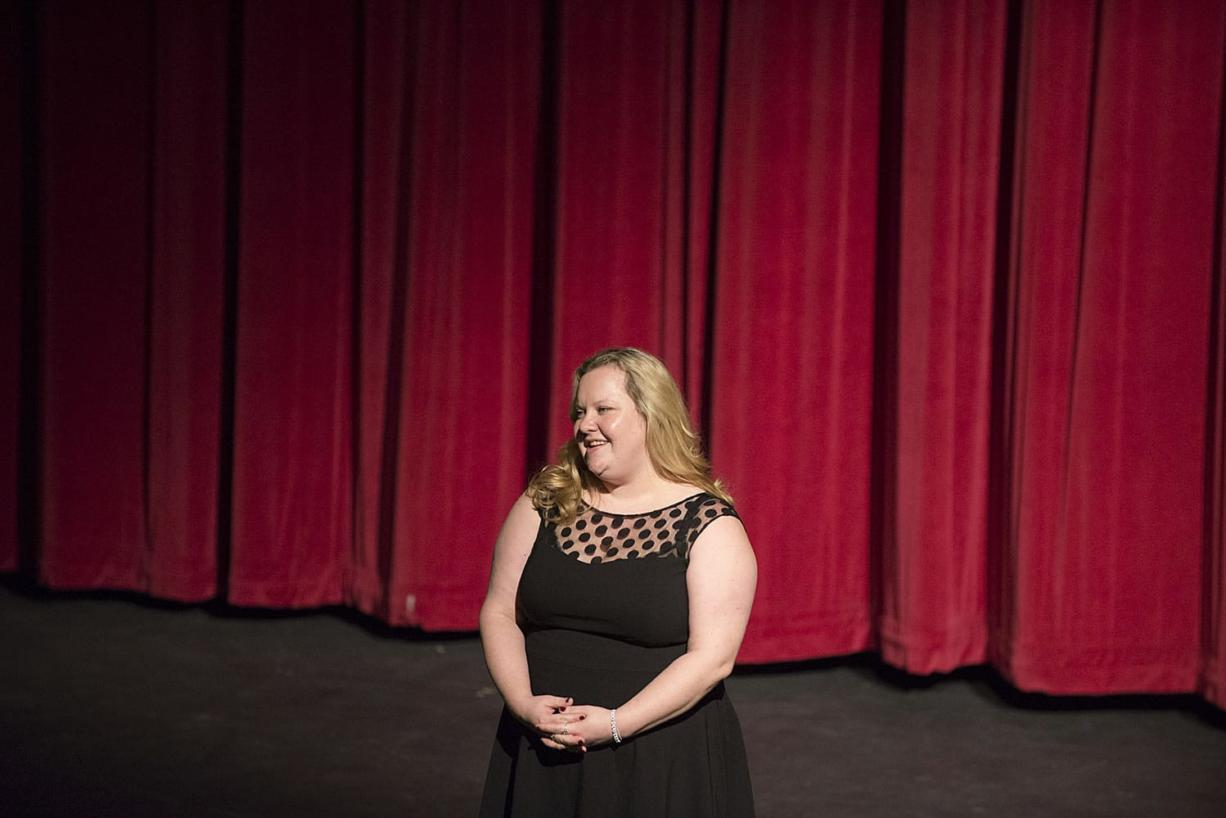 "Director Margaret Gorman, Evergreen High School's new drama teacher, greets the audience before ""The Three Musketeers"" on Thursday at Evergreen High School's theater. (Amanda Cowan/The Columbian)"