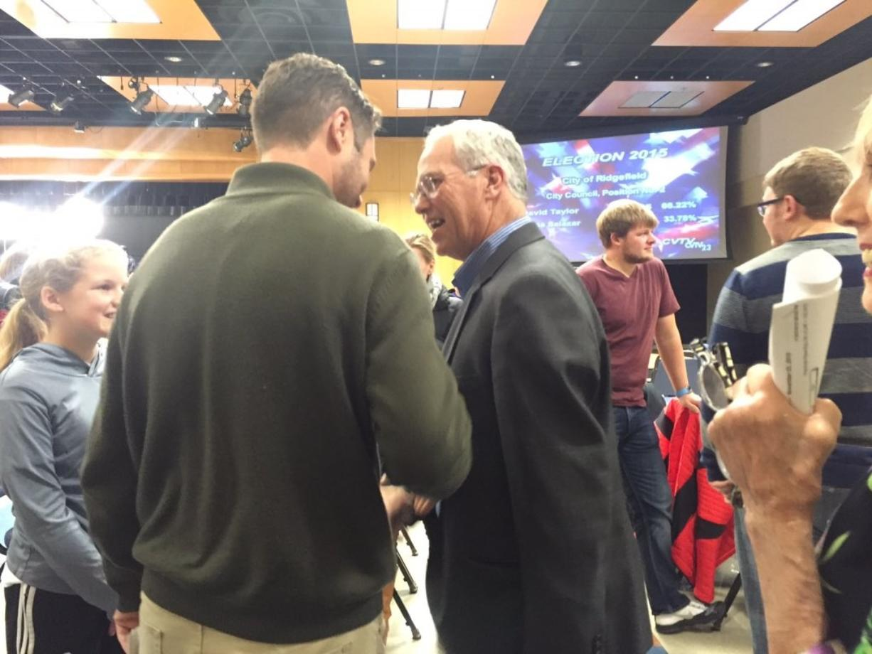 Clark County chair candidate Marc Boldt, center, talks to Vancouver City Councilor Bart Hansen, left, on Tuesday night in Vancouver shortly after preliminary election results were revealed.