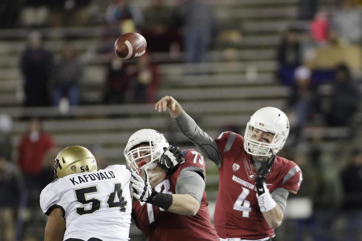 Washington State quarterback Luke Falk (4) throws a pass during the second half of an NCAA college football game against Colorado, Saturday, Nov. 21, 2015, in Pullman, Wash. Washington State won 27-3.