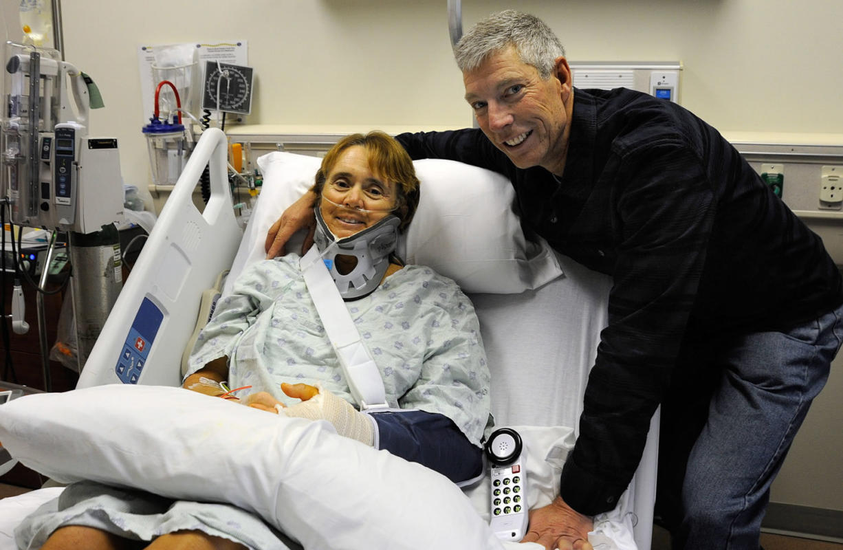 Cindy and Stephen Weber of Mount Vernon in her hospital room in Odessa, Texas. During their cross-country bicycle ride, Cindy was struck Jan. 17 on Highway 90 near Marathon, Texas, by a pickup pulling a horse trailer. She is recovering after four surgeries.