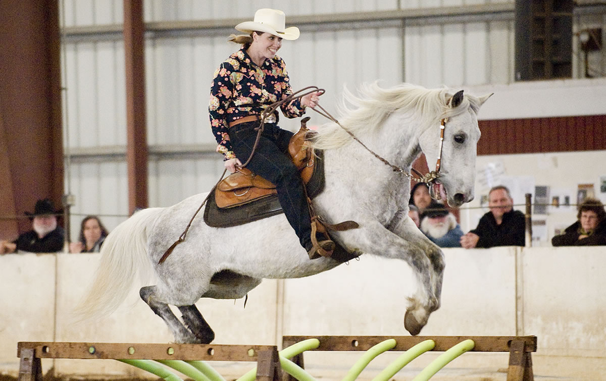 Jessica Bishop, from Scio, OR, riding Chief Seattle, competes in the Craig Cameron Extreme Cowboy Race at the Washington State Horse Expo, held at the Clark County Event Center, Sunday, February 19, 2012.