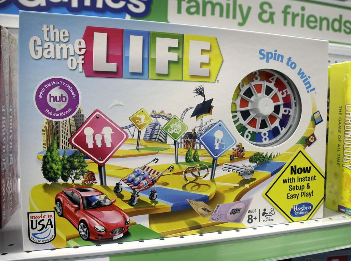 The board game The Game of Life has sold more than 30 million copies and was inducted into the Toy Hall of Fame. (Steven Senne/Associated Press)