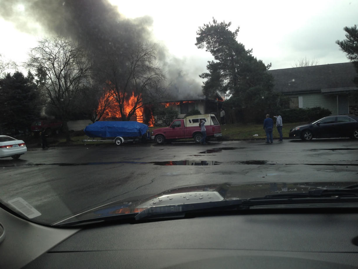 A passer-by, who didn't want his name published, sent this photo of a burning house to The Columbian. One woman died as the house burned Friday, Jan. 10, 2014, in Vancouver, Wash..