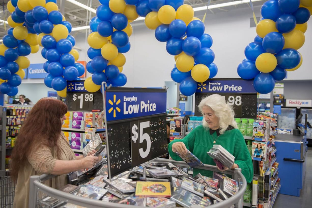 Bobbi Pratt of Orchards, left, sifts through the variety of discounted movies with her mom, Bernice Hayes, also of Orchards on Sept. 23 at the new Wal-Mart.