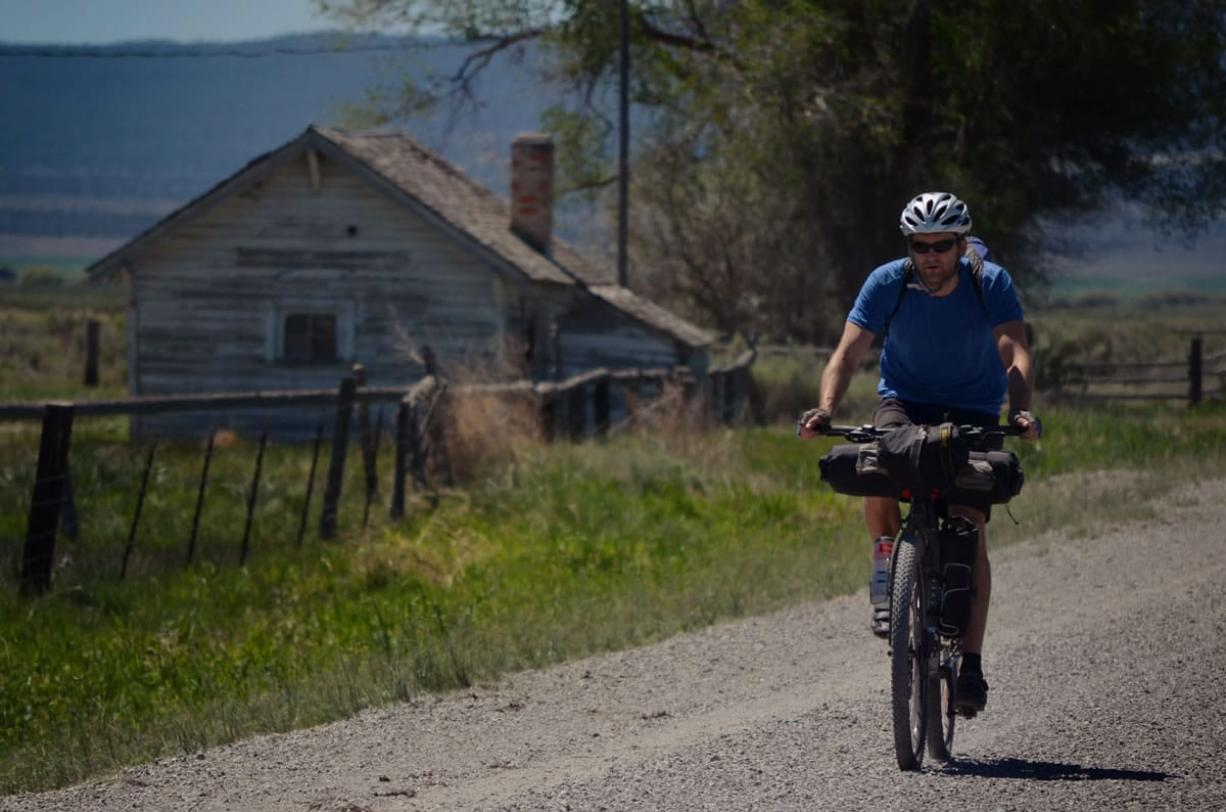 Donnie Kolb pedals down a gravel road near Silver Lake, Ore., in June. Kolb has been organizing gravel bicycle rides for the past five years, usually keeping his events a bit on the down-low.  His outings are unsupported and unsanctioned, have no entry fee and crown no winner.