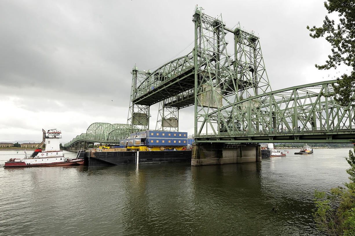 A section of a huge drilling rig goes under the Interstate 5 Bridge in July 2009 on its way to Alaska's North Slope.