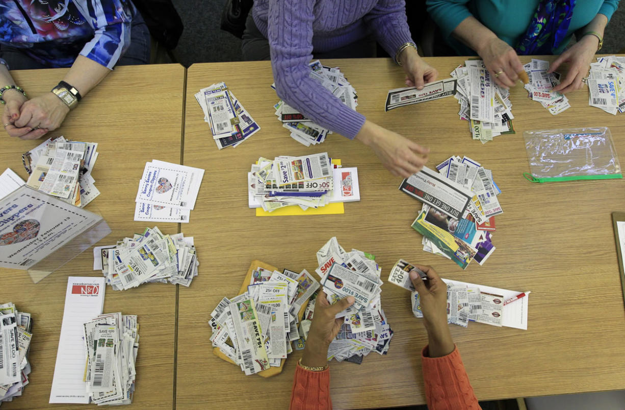 Members of the Savvy Savers Coupon Clippers gather twice a month to swap their unwanted coupons for ones they want/need at Southeast Regional Library in Garner, N.C.