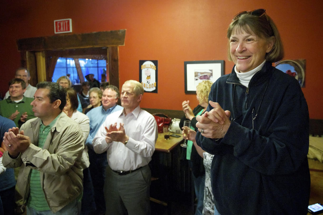 Shonny Bria, right, former superintendent of Battle Ground Public Schools, reacts to the news that the district passed its four-year maintenance and operations levy on April 23. District residents have sharply criticized the school board for its secrecy surrounding the buyout of the contract for Bria, who retired June 30.