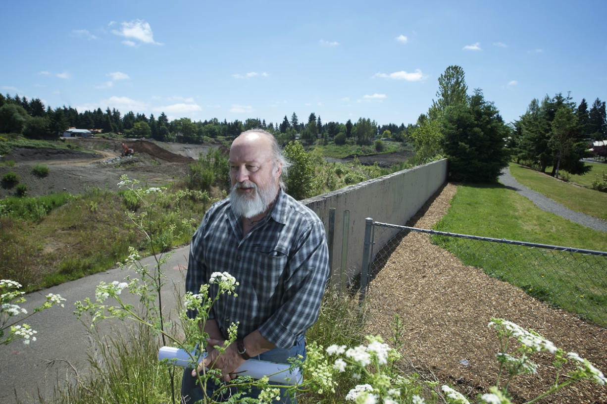 Stephen Wille, chairman of the Countryside Woods Neighborhood Association, stands last week at the boundary between First Place Neighborhood Park and the Evergreen Pit.