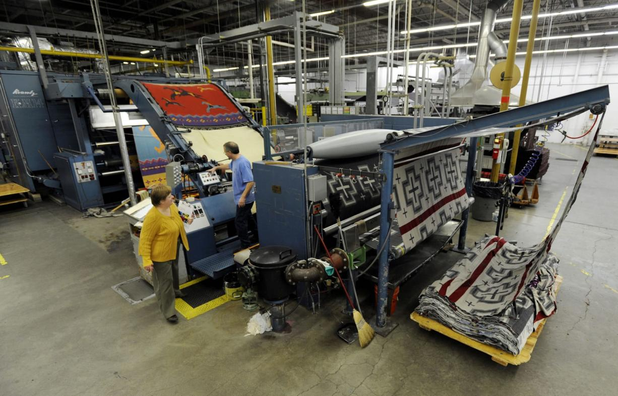 Employees work on the napping machine at the Pendleton Woolen Mills textile mill in Washougal in November.