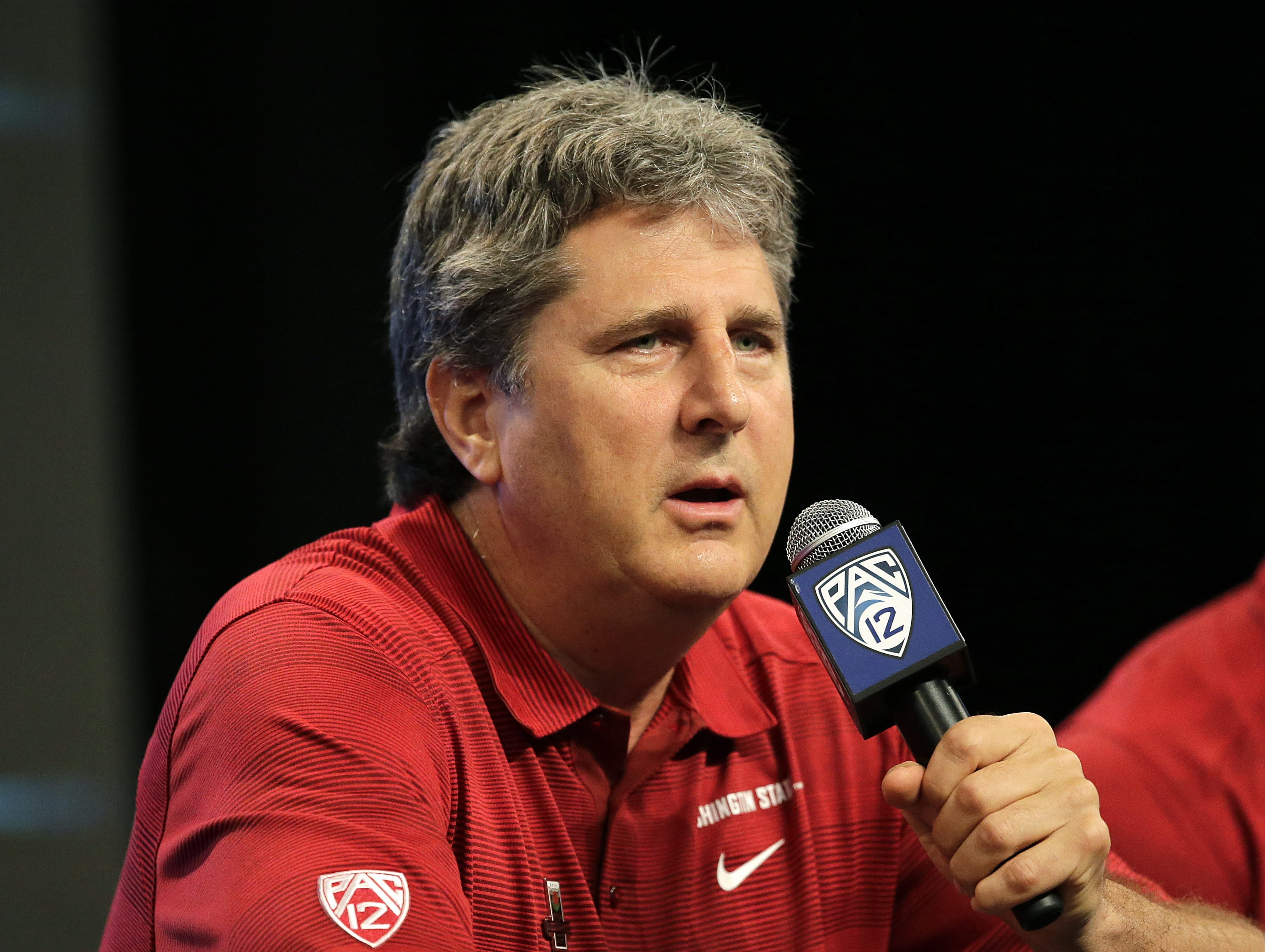 Washington State head coach Mike Leach talks to the media during the NCAA college football Pac-12 Media Day on July 26 in Culver City, Calif.