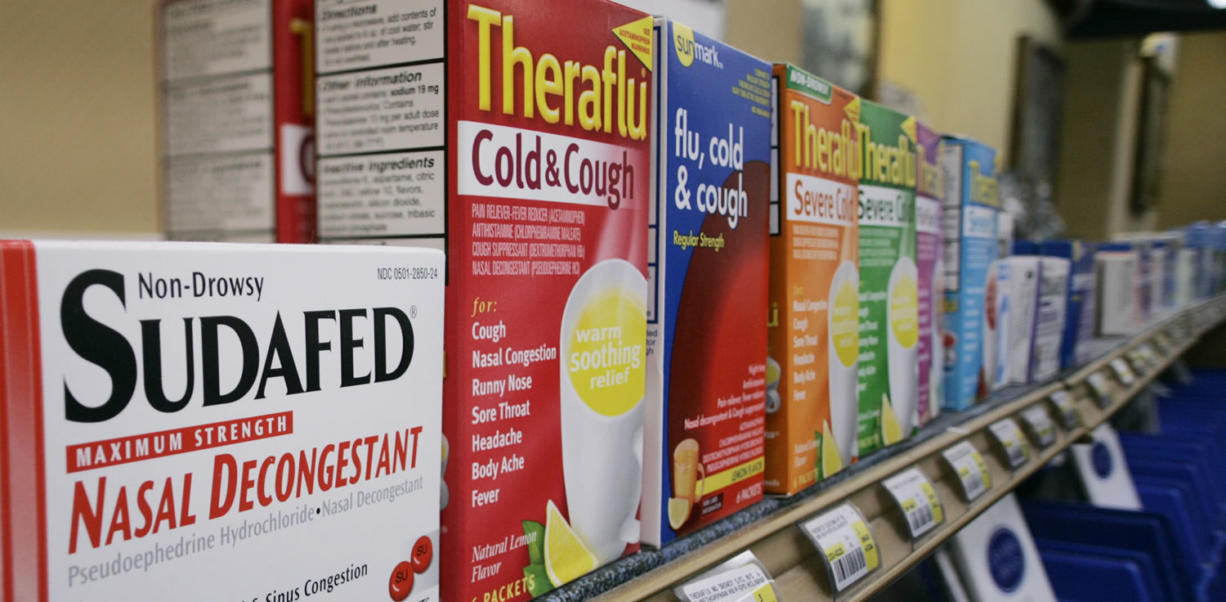 Boxes of cold medicines are seen behind a Portland pharmacy counter in 2005.