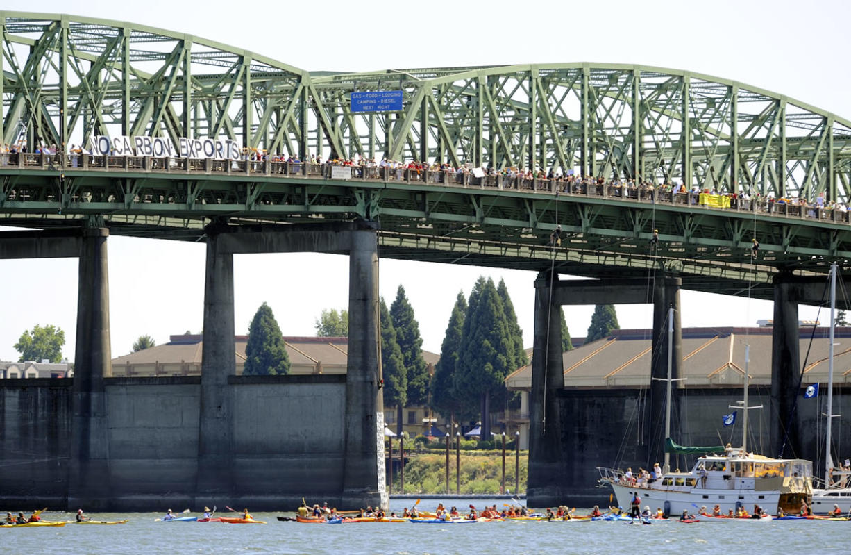 Hundreds of protesters cross the Columbia River in Vancouver on July 27 in support of an amphibious demonstration at the Interstate 5 Bridge against proposed fossil fuel facilities in the Northwest.