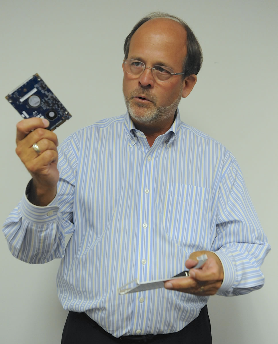 Randy Barber, president of CRU Inc., explains a device designed to safely store digital photo files.