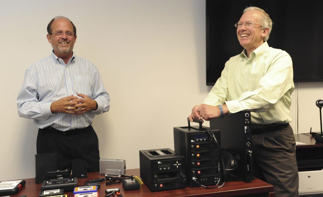 Randy Barber, left, president of CRU Inc.