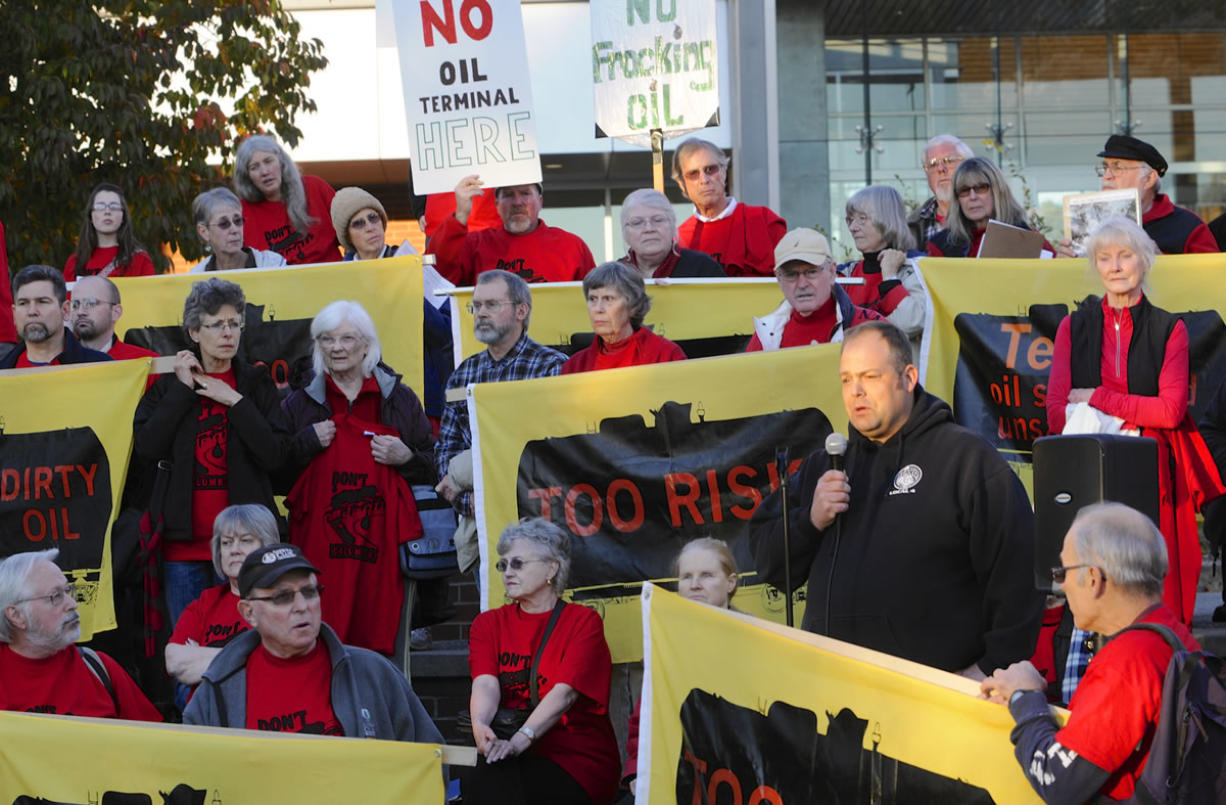Cager Clabaugh, president of the International Longshore and Warehouse Union Local 4, speaks Tuesday during a rally against a proposed oil terminal in Vancouver. The local union opposes the project, Clabaugh said, despite the fact that it could benefit from the jobs it would provide.
