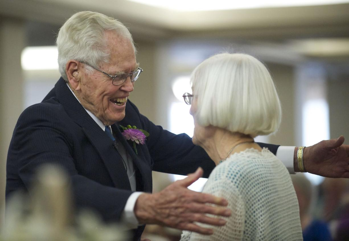 John Deurwaarder and his bride, Alta Lunsford, share a hug after Saturday's wedding.
