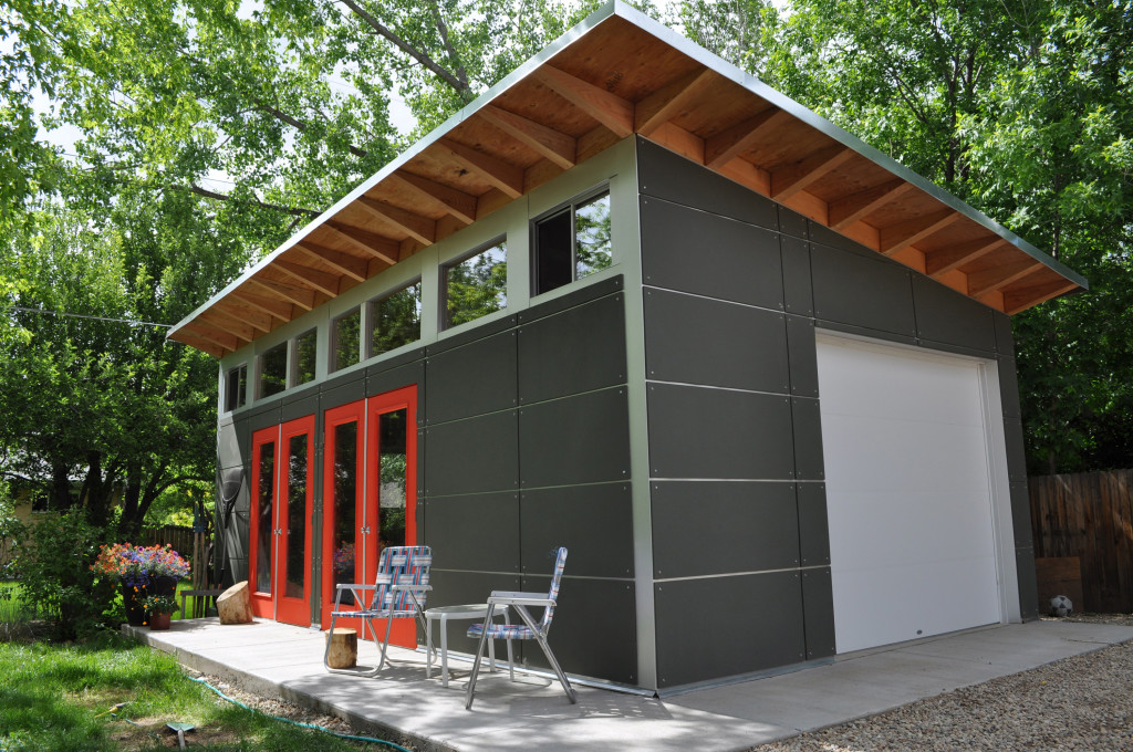 backyard living space and storage is achieved in a large studio shed with  an easy-