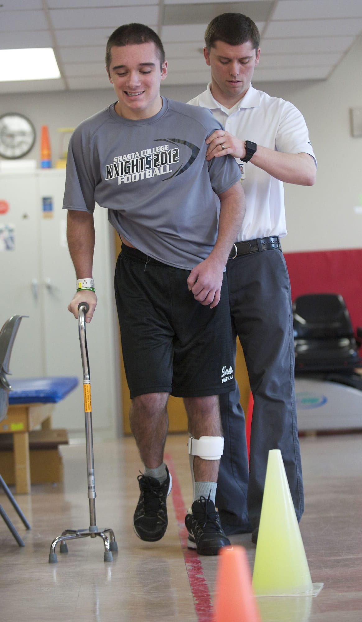 Tyler Burton, who suffered a traumatic brain injury after being assaulted last year, works with his physical therapist, Tim Hughes, at PeaceHealth Southwest Medical Center on Monday. Burton will be discharged from the hospital's inpatient rehabilitation center in the coming days. He arrived at the center in late December.