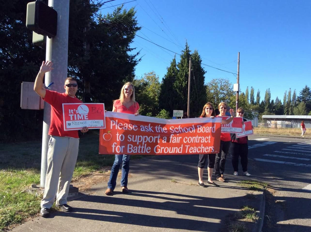 Battle Ground teachers, who have been without a contract since Sept. 1, wave banners in support of a fair contract.
