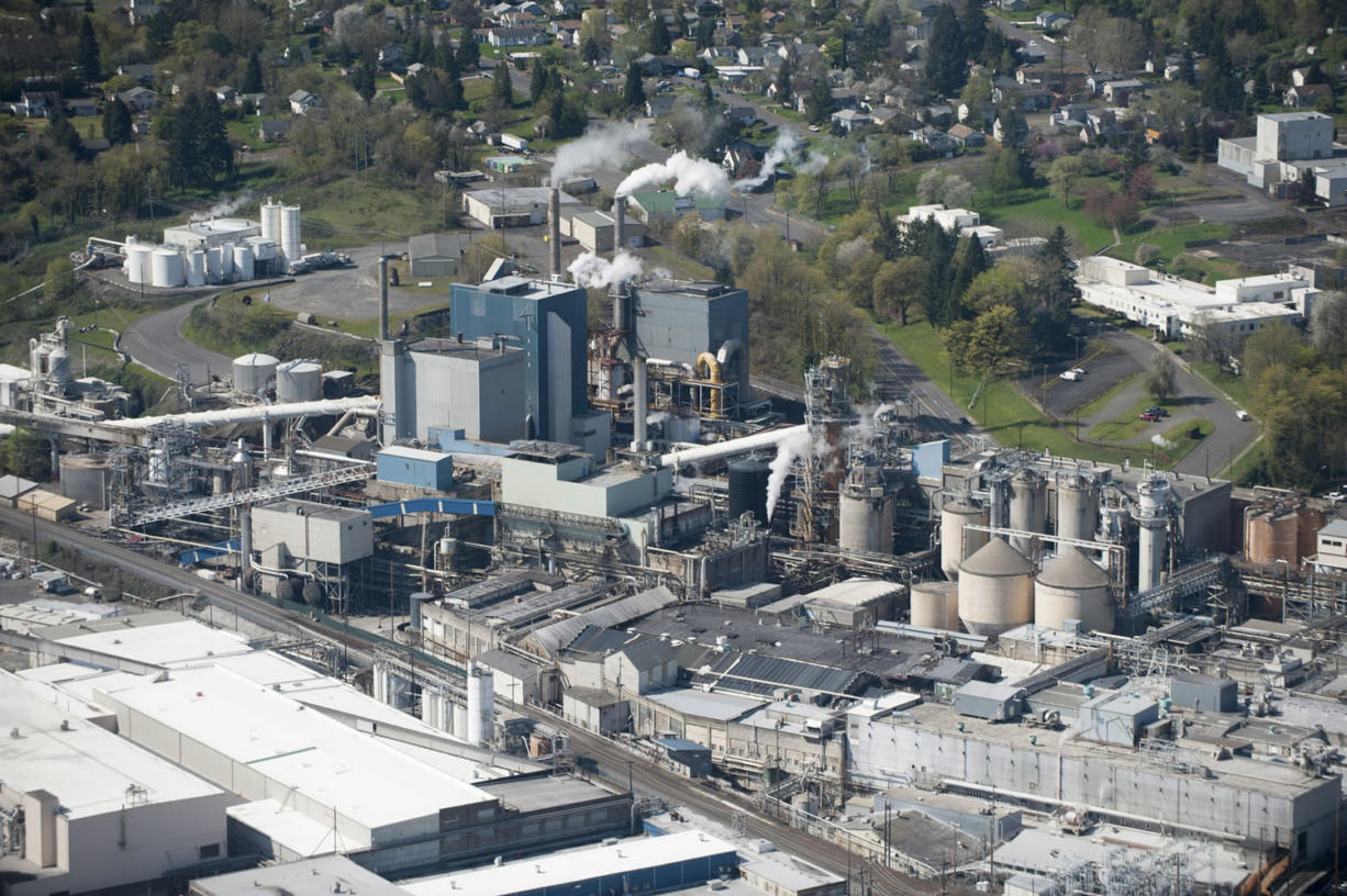 """An aerial view of the Georgia-Pacific paper mill in Camas on March 26. """"When I graduated from high school, those in my class who hiked down the hill were basically guaranteed a good paying job from Crown Zellerbach,"""" said former Camas Mayor Nan Henriksen, who helped diversify the city's economy away from reliance on the mill in the 1980s."""
