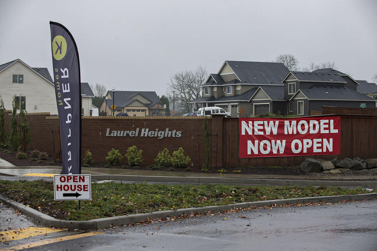 Signs advertise homes for sale in Laurel Heights in Ridgefield.