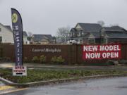 Signs advertise homes for sale in Laurel Heights in Ridgefield.