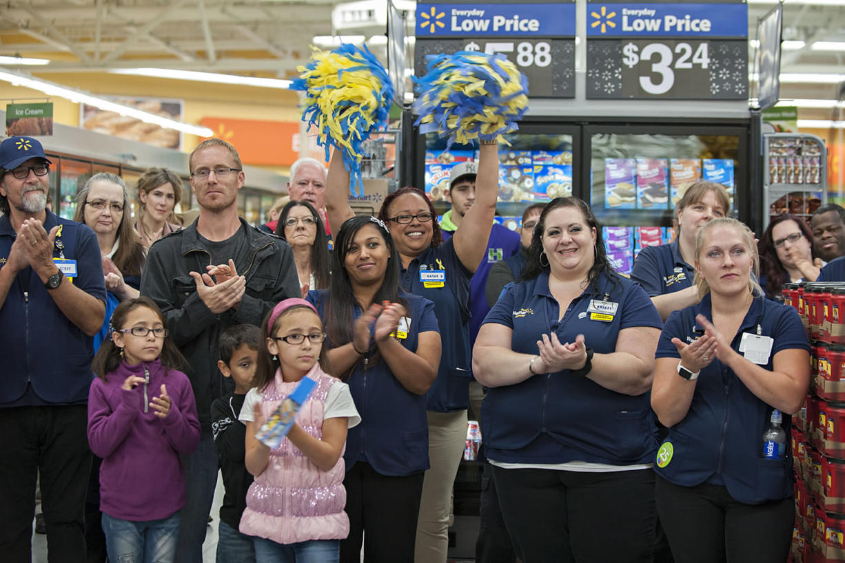 Wal-Mart employees join shoppers and community leaders in celebrating the opening of the Orchards store in September.