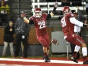 Washington State's Parker Henry (29) celebrates a defensive play against Stanford on Oct. 31 in Pullman. Henry ranks fourth on the team with 69 tackles headed into the Sun Bowl against Miami on Dec. 26.