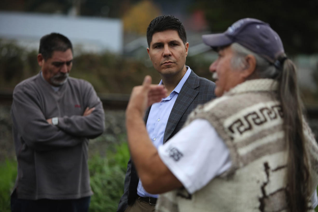 Native American lawyer Gabriel Galanda, center, listens to Nooksack members talk about disenrollment. (Photos by Steve Ringman/Seattle Times)