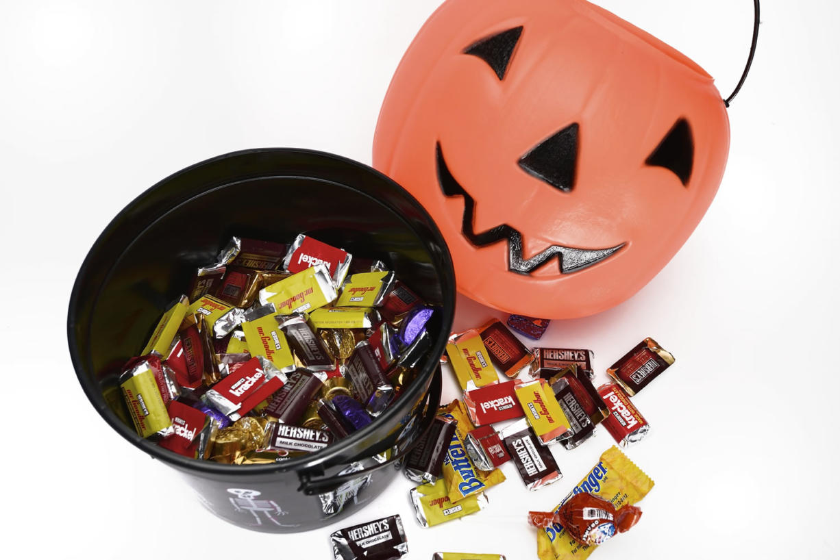 Kids may collect miniature candies while trick-or-treating, but local dietitians and pediatricians warn the calories in those smaller versions can quickly add up.