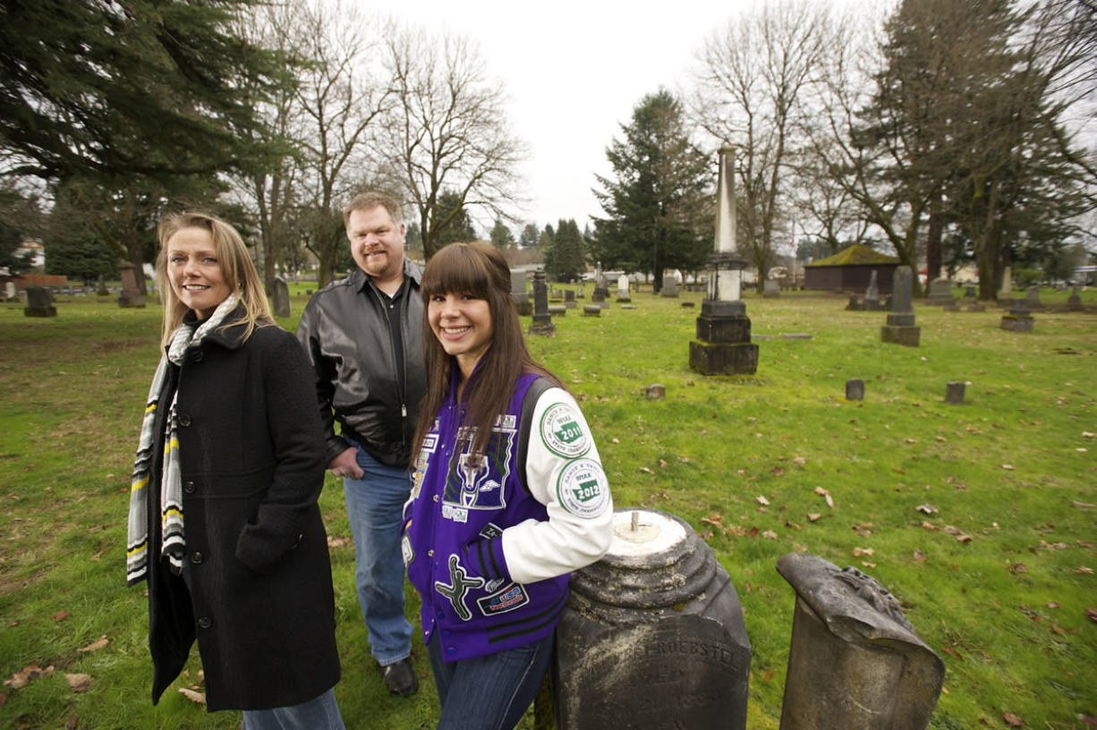 Zoe Hall, 17, a junior at Heritage High School, stands with her parents, John and Dani Hall, in Vancouver's Old City Cemetery in the Central Park Neighborhood.